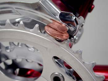 penny between front derailleur and chainring Give A Little Front Derailleur Love
