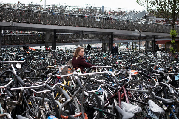 This three tiered bike parking lot is a tourist attraction. Photo courtesy of New York Times